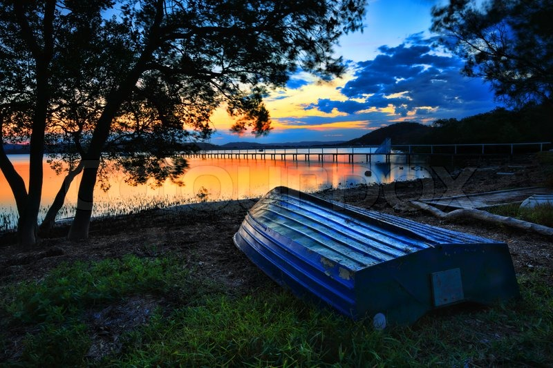 Beautiful Sunset Landscape With Blue Weathered Upturned Boat At Shoreline Low Tide This Pretty Spot Is Kincumber Australia Please Note Long Exposure