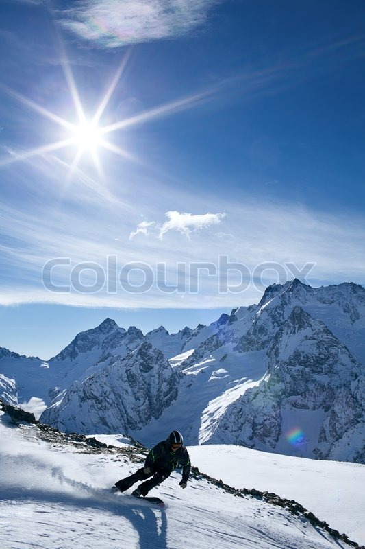 Winter sport snowboarding in snow mountain, stock photo