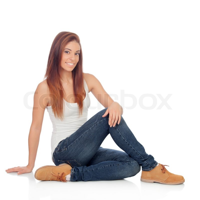 casual young woman sitting on the floor isolated on a white background stock photo colourbox. Black Bedroom Furniture Sets. Home Design Ideas