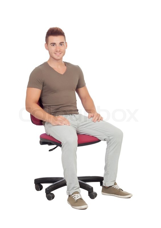 Casual Young Man Sitting On An Office Stock Photo