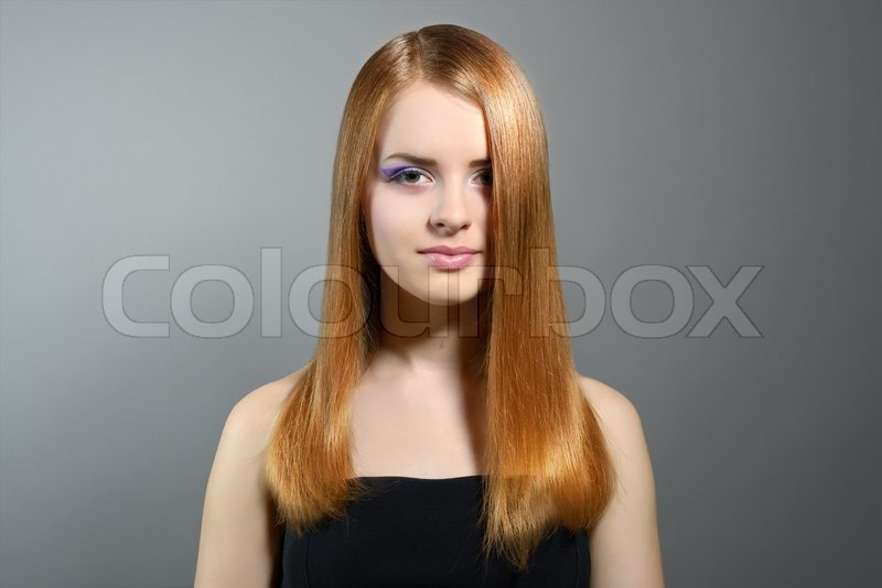 Attractive Girl With Straight Hair On Gray Background Stock Photo