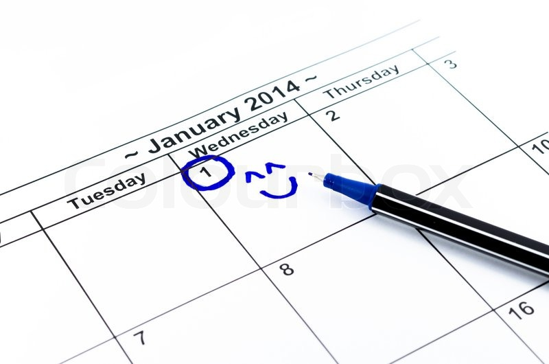 Blue circle with smile. Mark on the calendar at 1St January 2014, stock photo