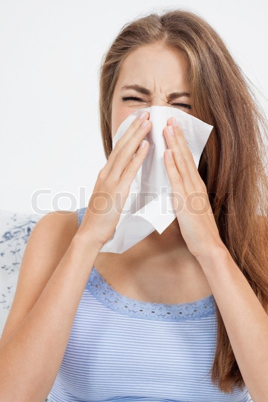 Young brunette woman with flu cold influenza portrait at home, stock photo