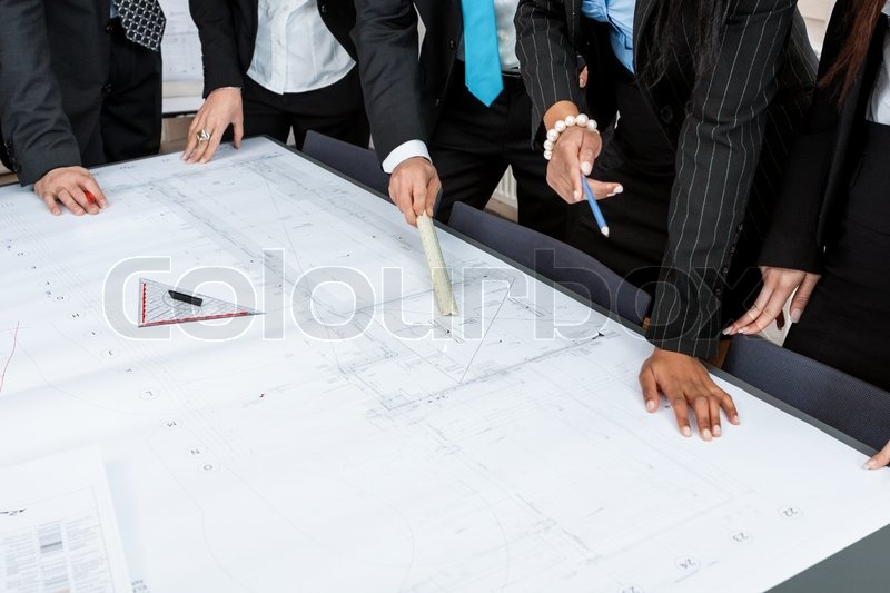 business people team in office plan blueprint s