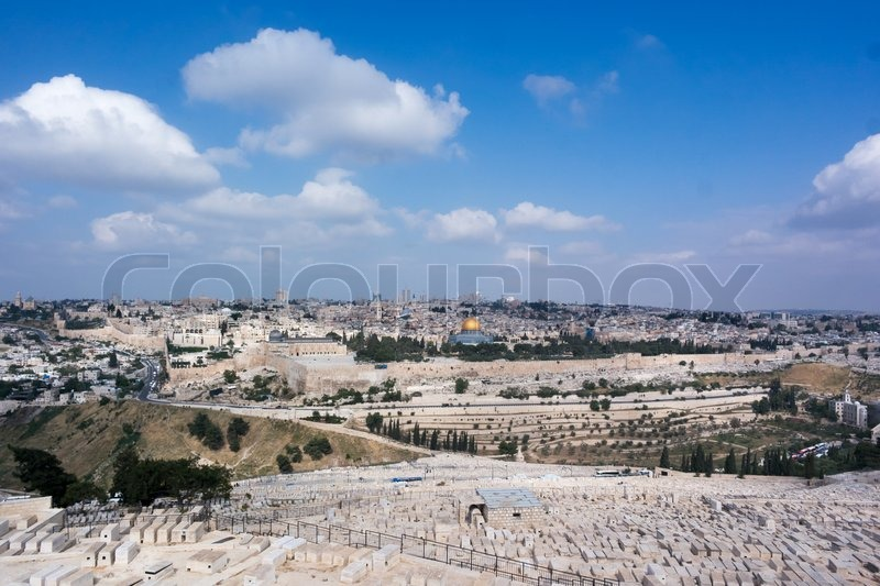 Stock image of 'On top of the mount of olives, overlooking the city of Jerusalem. The graves on the foreground being of a lot of Jewish people wanting to be closest to the spot where Jesus said he will come back.'