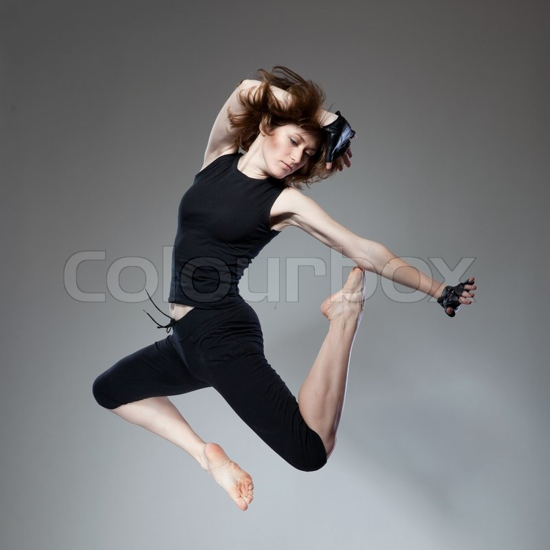 Attractive jumping woman, stock photo