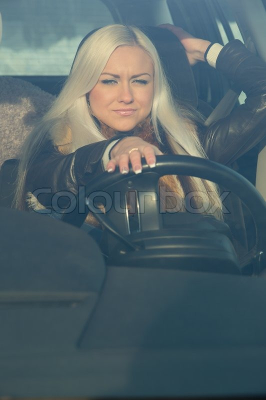 Sexy Girl Sitting Behind The Wheel Of A   Stock Photo -3465