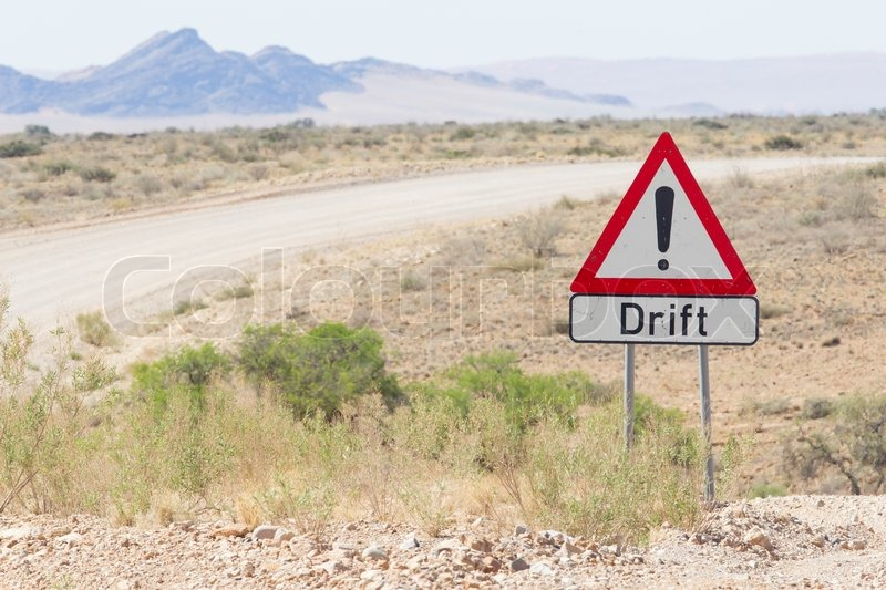 Drift warning sign at a gravel road in Namibia, stock photo