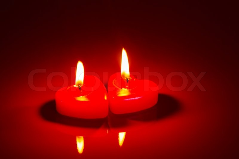 Two Red Burning Candles Against Dark Background Stock Photo Colourbox