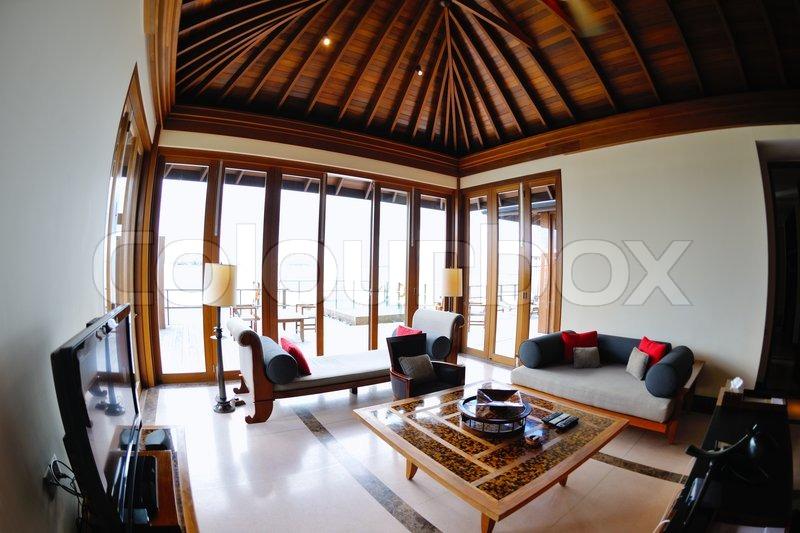 Tropical water home villas resort on Maldives island at summer vacation, stock photo
