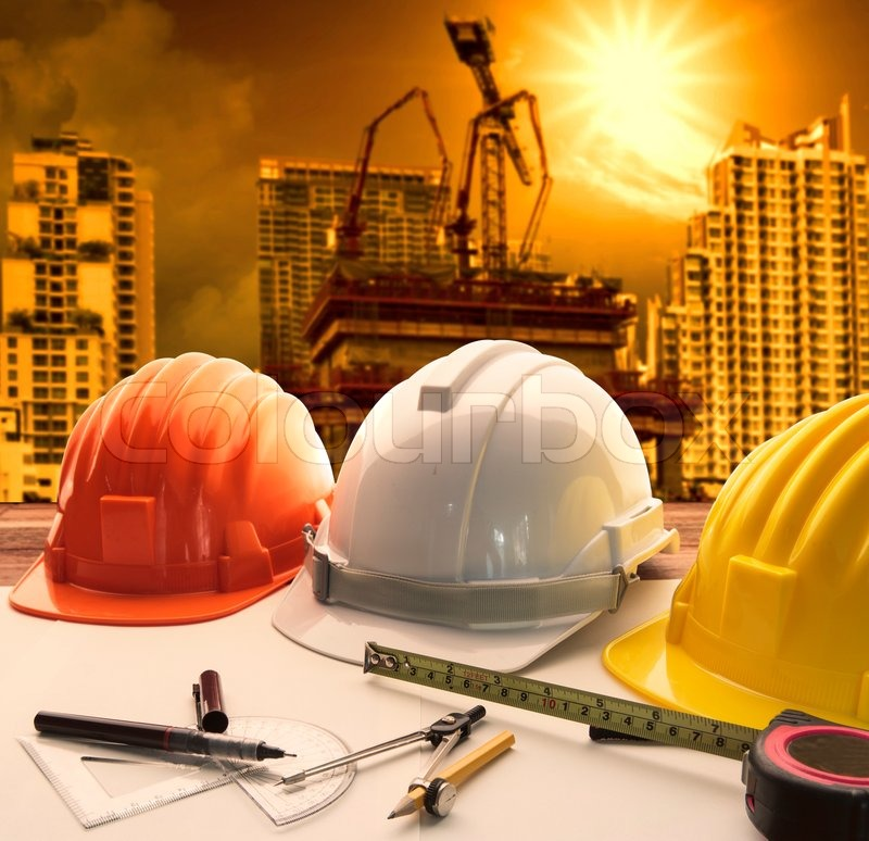 Safety helmet on architect engineer working table with for What type of engineer designs buildings