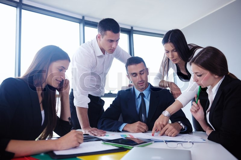 Group of happy young business people in a meeting at office, stock photo