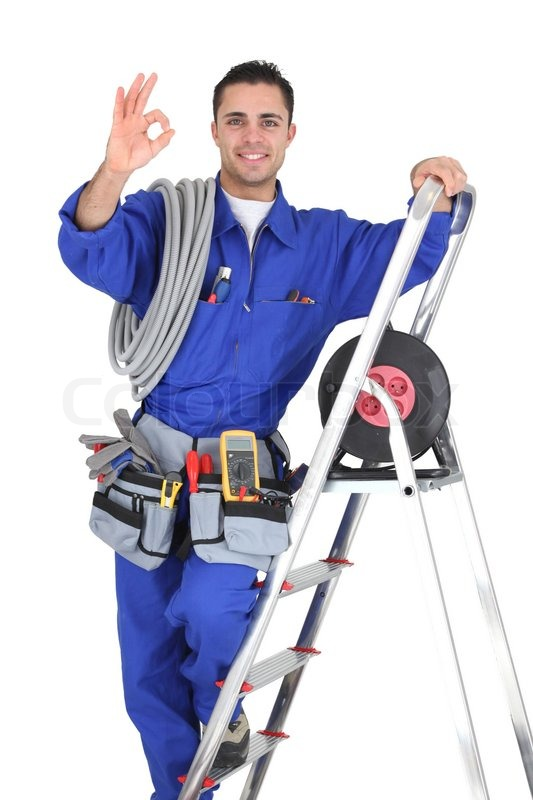 young electrician in studio looking happy stock photo colourbox. Black Bedroom Furniture Sets. Home Design Ideas