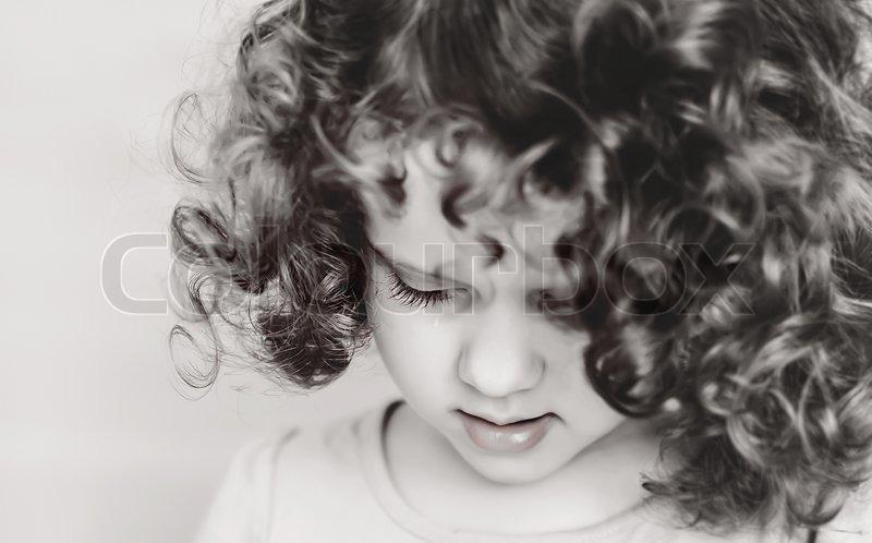 Curly girl closeup eyelashes and lips, stock photo