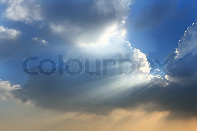 Sun break through the big white cloud and blue sky background, stock photo