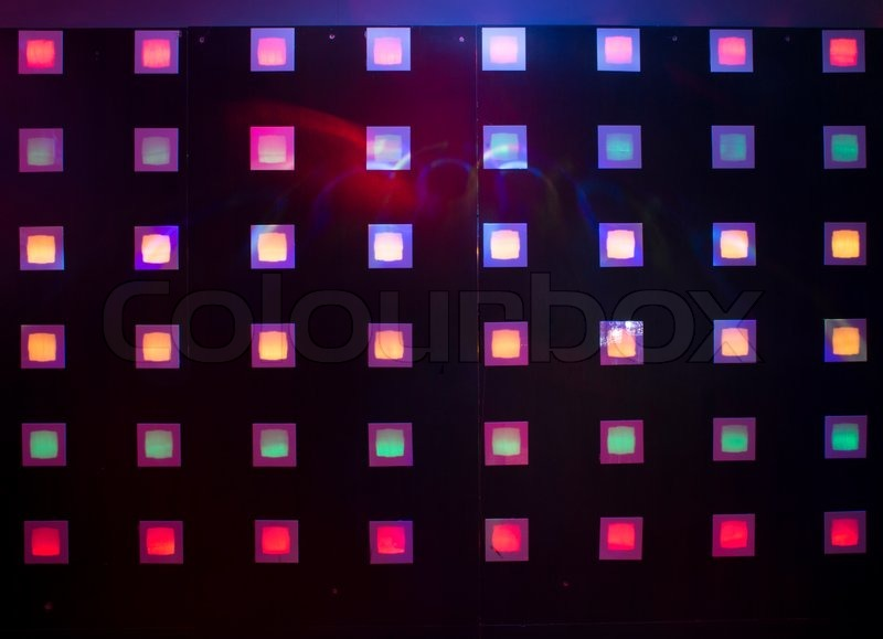 Disco with colorful lights. Dancing, stock photo
