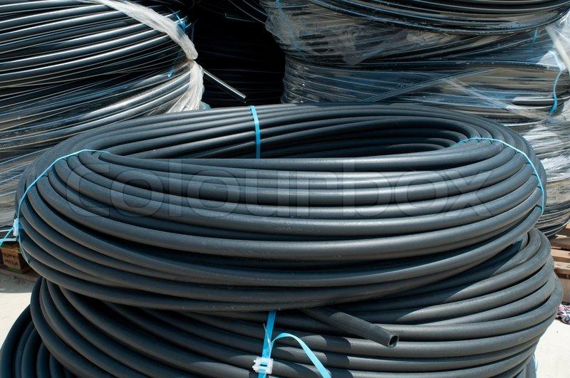 Coiled black PVC hoses. Polyethylene tubing, stock photo