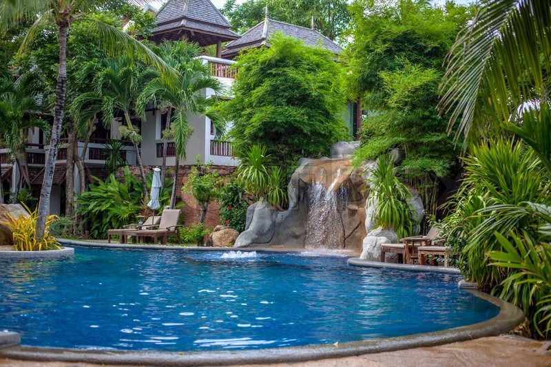 Tropical waterfall landscape in relaxing spa resort, stock photo