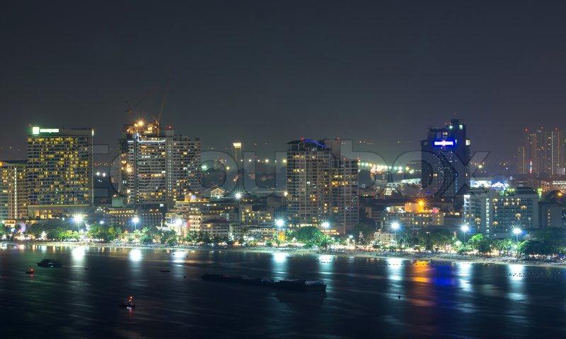 Pattaya cityscape Modern building sea beach side at night time,Thailand, stock photo