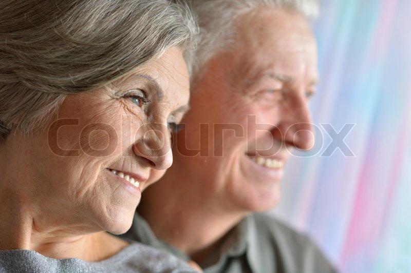 Portrait of happy older pair, stock photo