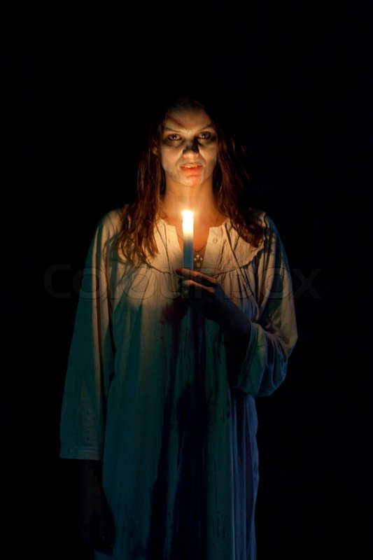 Bloody and scary looking zombie woman | Stock Photo ...