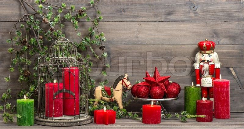 vintage christmas decorations with red candles antique toys nutcracker and rocking horse retro style picture stock photo colourbox
