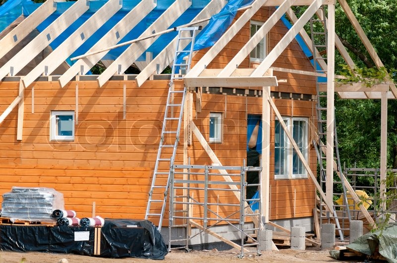 Construction of a wooden house, stock photo