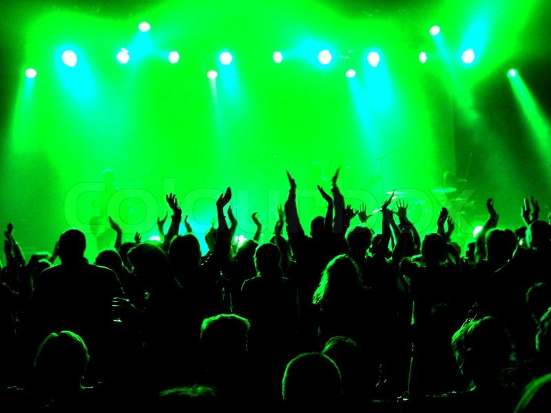 Crowd At Concert With Stage All In Green Light Stock