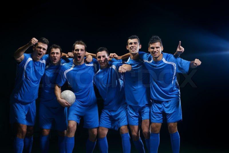 Soccer players team group celebrating the victory and become champion of game while holding win coup, stock photo