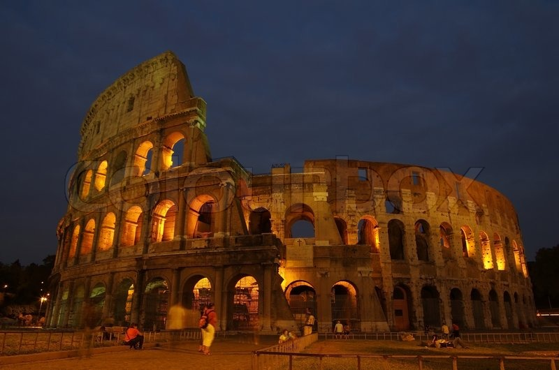 ROME, Italy - SEPTEMBER 27: Colosseum on September 27, 2011 in Rome Italy. The Colosseum is one of Rome\'s most popular tourist attractions in the evening, stock photo