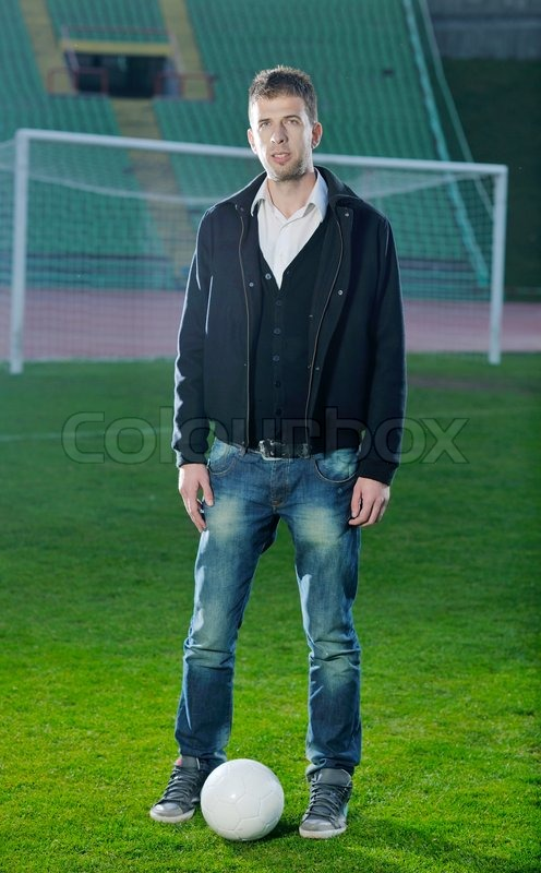 Business man sport manager and executive at soccer ball athletic stadium and race track, stock photo