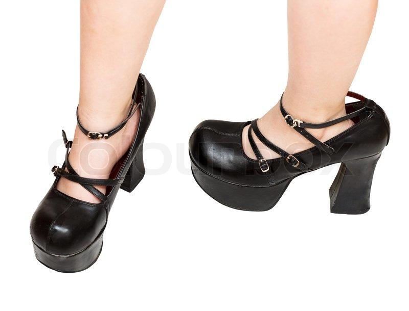 trying on black platform shoes