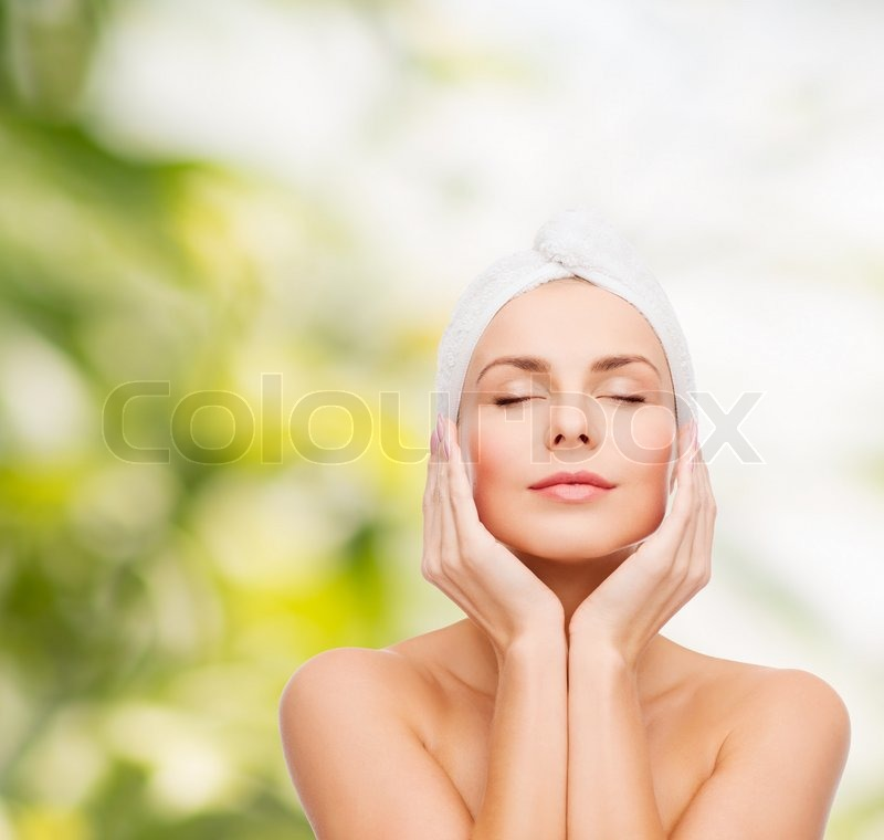 Health, spa and beauty concept - beautiful woman in towel, stock photo