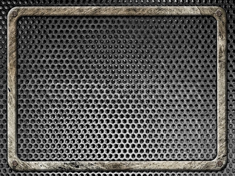 Steel frame bolted in grunge style on a background of black metal grilles, stock photo