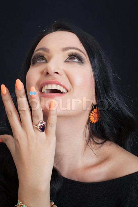 Beautiful smiling, excited woman looking up, stock photo