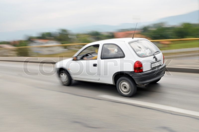 Fast car moving with motion blur, stock photo