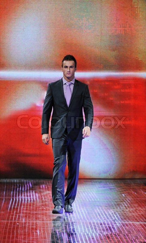 Handsome man male model at fashion show stage event, stock photo