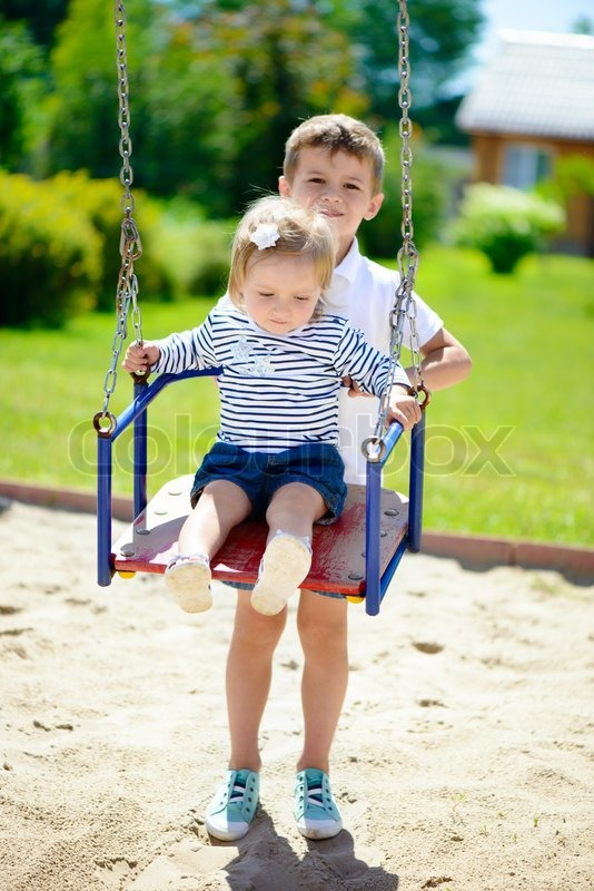 Little Cute Brother And Sister Swinging Stock Photo Colourbox