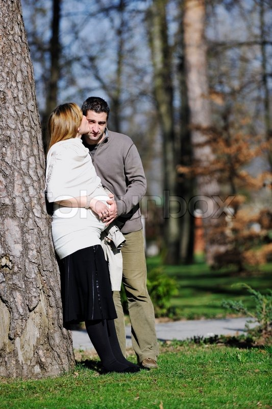 Happy young married family couple outdoor in nature have ...
