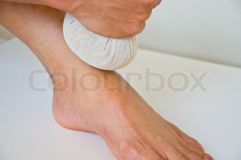 Foot massage with herbal compressball, stock photo
