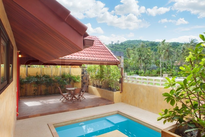 Panoramic view of nice summer house patio with swimming pool, stock photo