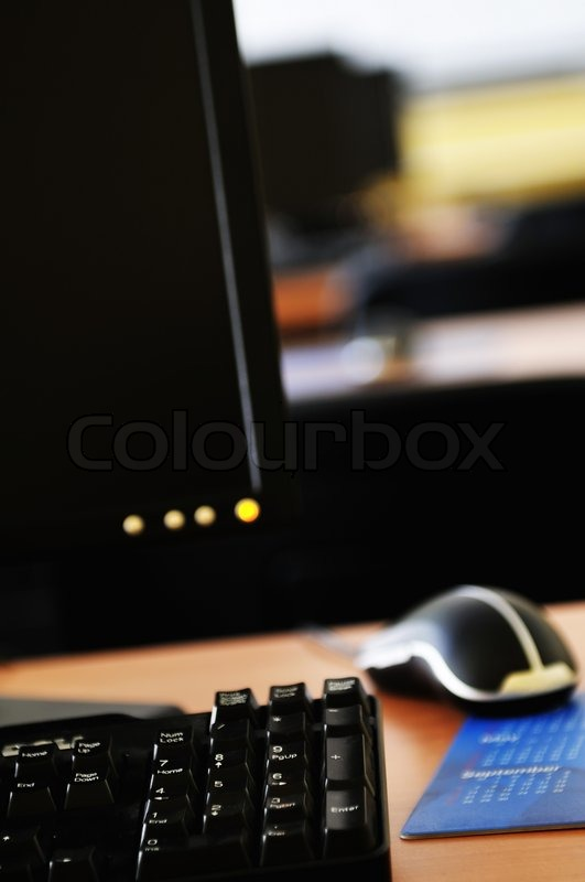 Brand new computer with tft monitor in modern classroom at school, stock photo