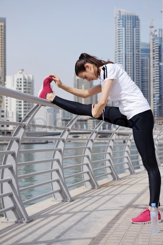 Young beautiful woman jogging and running on morning at park in the city. Woman in sport outdoors health and fitness concept, stock photo