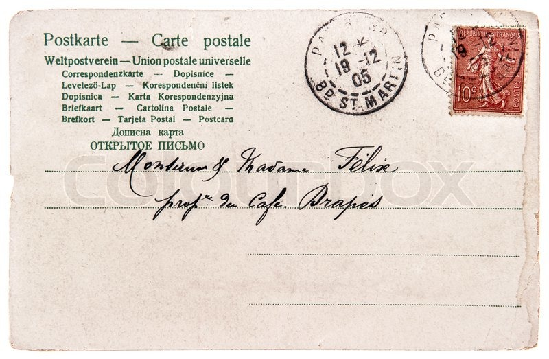 editorial image of old used handwritten postcard letter with stamp and unreadable undefined address text