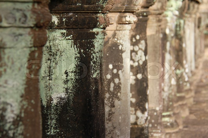 Ancient Stone Pillars : Close up of ancient stone pillars at angkor wat stock
