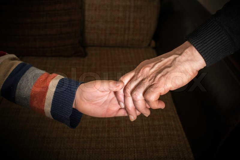 Two hands caught. Adult and child hand, stock photo
