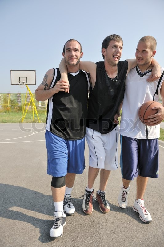 Basketball player have foot trauma strech and injury at outdoor streetbal court, stock photo