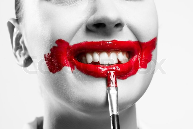 Stock image of close-up of a female vivid red mouth, lipstick red paint