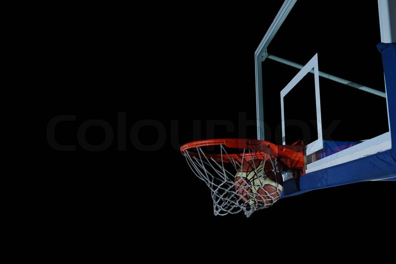Basketball ball, board and net on black background in gym ...