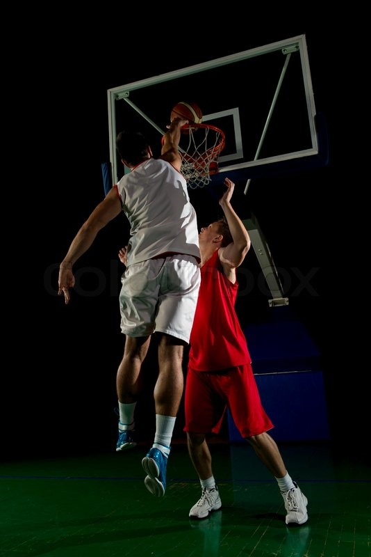 Basketball game sport player in action isolated on black background, stock photo